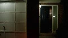 Burglary - Panning across ajar door broken into by criminal Stock Footage