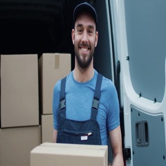 Smiling Delivery Man Holds Cardbord Box. Stock Footage