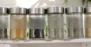 Spices, seasonings in small glass jars Stock Footage