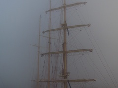 Ship with flags in the fog early morning. Regatta competition.Video. Stock Footage