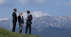 Successful Businesspeople Collaboration Surrounded by Beautiful Nature Landscape Stock Footage