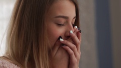 Teenage girl looking at the window, closing her mouth with hands, negative Stock Footage
