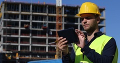 Master Engineer Navigate Using Digital Tablet and Examine Unfinished Apartments Stock Footage