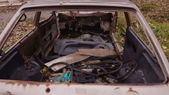 Rusty old abandoned car on the side of the road. Stock Footage