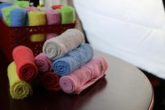 Set of multi-colored towels Stock Photos
