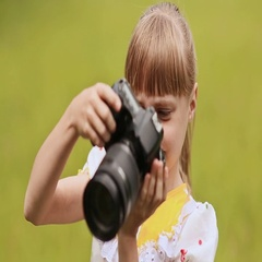 Teen girl making photo using the camera outdoors in the summer Stock Footage