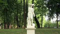 Antique Marble Statue Standing at Landscape Park Surrounded by Green Trees Stock Footage