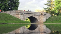 Bridge in Landscape Park of Pavlovsk Reflected Like in Mirror in Pond's Water Stock Footage