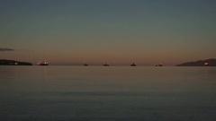 Timelapse of container ships anchored in English Bay at dawn. Stock Footage