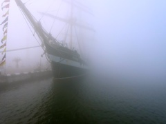 Ship with flags in the fog early morning. Regatta competition. Aerial video. Stock Footage