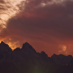 Cloudy sunset, colorful red sky, sky and mountains on background. Stock Footage