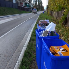 The enviroment, recycle boxes roadside with traffic, wide shot Stock Footage