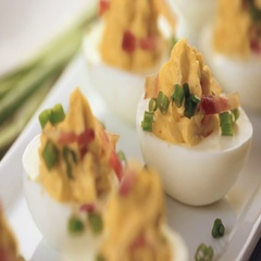 Deviled eggs garnished with green onions and bacon. Stock Footage