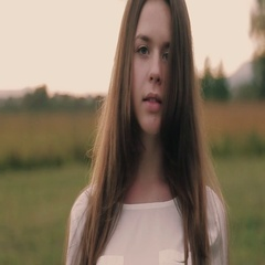 Young attractive European girl with a long hair in a white blouse gesturing Stock Footage