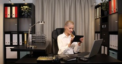 Positive Businesswoman Manager Using Digital Tablet Excited Good News in Office Stock Footage
