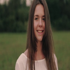 Lovely young girl charming smile and stroking her amazing hair. Natural beauty Stock Footage