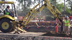 New construction, drilling holes with tractor Stock Footage