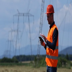 Electrician Man Work Digital Tablet Check Power Plant Activity Electricity Pylon Stock Footage