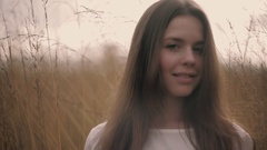 Charming European girl looking towards the camera and smilling. Natural beauty Stock Footage