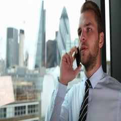 Handsome Businessman Cooperation Dialogue at a Mobile Phone London Skyline Tower Stock Footage