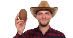 Optimistic Charming Farmer Man Showing Sweet Coco Nut Presentation Juicy Dessert Stock Footage