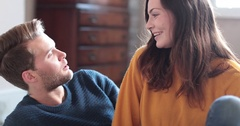 Couple at home talking and laughing Stock Footage