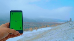 Green smartphone screen for tracking and keying Stock Footage