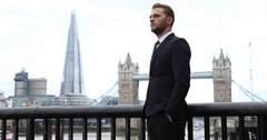 Business Man Looking Sad and Disappointed Brexit News London Skyline Landmark UK Stock Footage