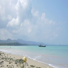 Fishing boat in the distance at Bangsak Beach, Khao Lak, Thailand Stock Footage