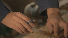 Master carpenter makes basting on the Board with a pencil, draws, craftsman work Stock Footage