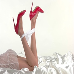 Legs in red heels lying. Stock Footage