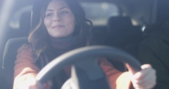 Woman driving car listening to music Stock Footage