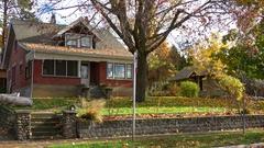 Architecture, brick house on quiet street autumn, establishing shot Stock Footage