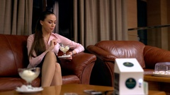 View of businesswoman eat dessert during break Stock Footage