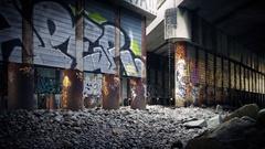 Moving Past Graffiti Covered Area Under Bridge Stock Footage