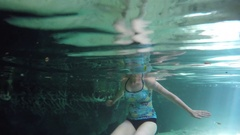 A woman swimming in underground cave cenote in Mexico Stock Footage
