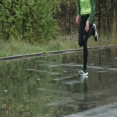 Runners Sneakers Slapping against Puddles Stock Footage