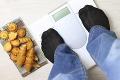 Scales calories pastry weight Stock Photos