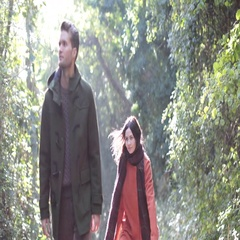 Couple having fun in forest in Fall Stock Footage