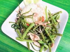 Thai food , Stir fried morning glory with pork Stock Photos