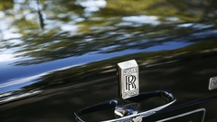 Panning to Luxurious Rolls-Royce parked on street Stock Footage