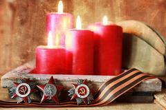 Old military decorations since World War II on a wooden Stock Photos