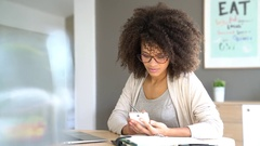 Mixed race woman working from home on laptop computer Stock Footage