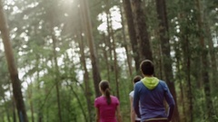 People walking in a forest Stock Footage
