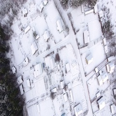 Snow covered roofs of frozen houses and courtyards. Karelia, Russia Stock Footage