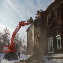 Rundown building. Bucket destroys the second floor two-storey building Stock Footage