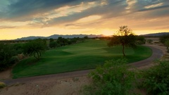 4K Aerial Drone Desert Golf Course Green Beautiful Sunset Dolly Sideways Stock Footage