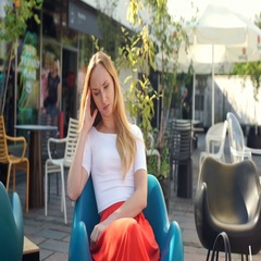 Girl looking morose while sitting in the cafe and having painful headache Stock Footage