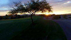4K Aerial Drone Desert Golf Course Fly Fairway at Sunset Bird Fly by Stock Footage