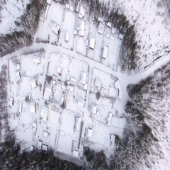 Top view at empty Russian village in wild wintry forest Stock Footage
